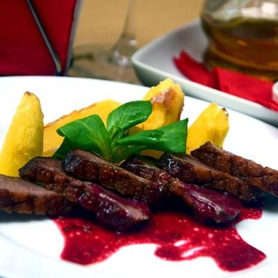 Duck breast with its forest fruit sauce, from GUXT Bistro.